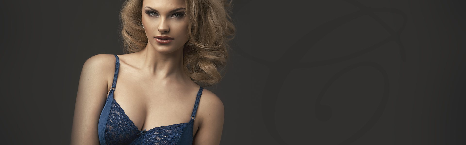 portrait of a model blonde woman wearing blue bra